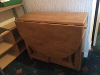 Oak effect stow-away table and 4 chairs