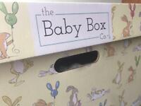 The Baby Box Co. Baby Box / Crib with organic baby grow and sleepbag.