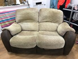 two seater recliner sofa, two tone tan and brown.