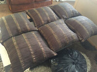 6 brown and gold cushions
