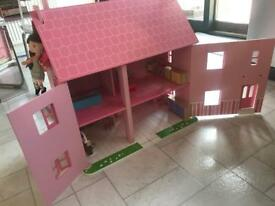 Pink wooden dolls house for sale