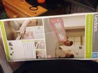 Lindam pink soft folding bed rail
