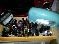 74 bottles of nail polish and 2 nail drying lamps