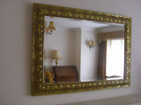 Mirror; Bevelled glass mirror in an ornate gilt coloured frame