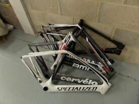 Job lot of 5 damaged carbon fibre bike frames. Original value of over £8000