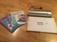 Challenge laminator with pouches.