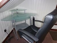 Glass Topped Corner Computer Desk with Black Computer Chair.