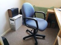 Blue office swivel chair with gas lift and arm rests