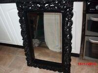 black framed mirror.