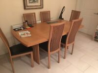 Extendable kitchen table and set of six matching chairs