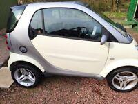 Smart Car shell, advertising, motorbike engine?