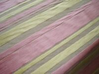 Roll of pale pink and lemon striped velvet fabric