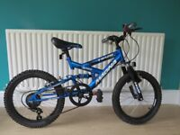 "GREAT BOYS FULL SUSPENSION 18"" WHEELED BIKE ""MAGNA TIDAL"".5 SPEED GEARS,EXCELLENT CONDITION WORKING."