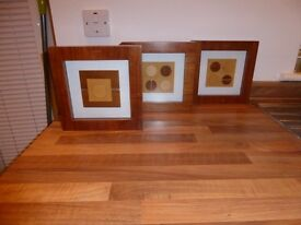 3 lovely contemporary wooden pictures 22cm x 22cm. Used good condition.