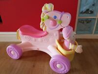 Fisher price pink musical pony ride on