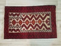 An Eastern rug the cream field with red borders (DELIVERY AVAILABLE)