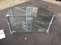 Two clear glass tv stands