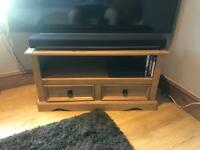 Matching wooden coffee table and TV cabinet.