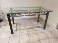 Glass topped table in very good condition plus 6 perspex ghost chairs - 2 with arms and 4 without