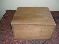 A plywood box with hinged lid.