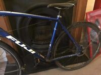 Blue road bike with mechanical disk brakes in good working condition