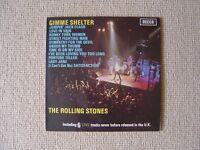 john lennon ' imagine l.p. + the rolling stones ' gimme shelter l.p