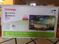 New in box 43in Toshiba 4K Ultra HD TV.