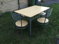 Dining table and chairs beech colour and metal. £10