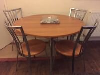 Modern Wood and Chrome Dining table and Four Matching Chairs