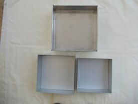 Three Square Cake Tins in Metal. 12, 10 and 9 Inches. In Excellent Condition.