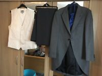 Grey suit, trousers and ivory waist coat blue crevat