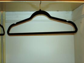 SLIM-LINE BLACK-VELVET-COVERED CLOTHES HANGERS - AS NEW - 230 - WILL SPLIT INTO SMALL QUANTITIES
