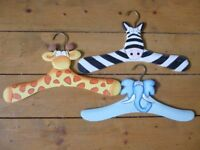 Child's wooden clothes hangers in animal designs