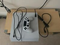 PS4, in immaculate condition, white with all the leads and one controller in the box plus six games