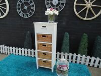 SOLID PINE DRAWERS UNIT WITH 4 RATTAN DRAWERS VERY SOLID UNIT AND IT'S IN VERY GOOD CONDITION