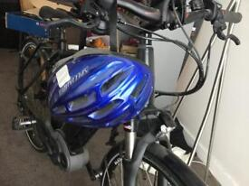 Electric bike with battery charger and helmet