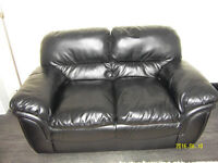 Two seater sofa black faux leather