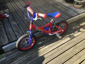 12 inch bicycle used with side wheels blue/red