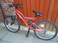 Halford's Trax boy's red bike. Suit age 9-12 approx.