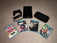 Wii U + 4 games, pro controller, sensor bar and cables.