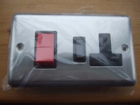 Cooker switch stainless finnish 45amp with 13amp socket
