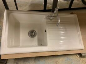 Porcelain sink and tap.