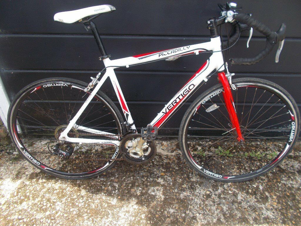 MENS BIKE VERTIGO PICCADILLY ROAD/RACING BIKEin Norwood, London - MENS VERTIGO PICCADILLY ROAD BIKE BEEN STANDING IN GARAGE BUT ALL SEEMS TO WORK WELL 21 FRAME 14 SPEED SHIMANO GEARS NICE LOOKING BIKE £65 no offers phone chris on 07933 546954