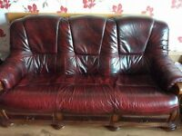 Three seater brown leather sofa and pair of leather chairs
