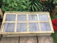Wooden glazed cold frame