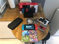 Nintendo Switch with Zelda, Mariokart Deluxe, case and charging cable AS NEW!!!