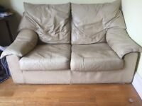 FREE: cream two seater leather sofa - very comfy!