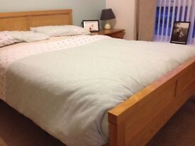 Wood framed double bed