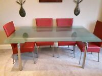 "Extending ""Casa"" Designer Glass Dining Table seats up to 8."