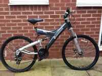 Adult shockwave mountain bike with front and back disc break